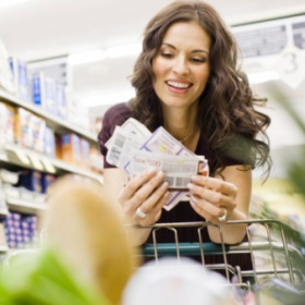 woman grocery coupon shopping